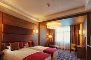 Кровать или кровати в номере Mercure Lipetsk Center