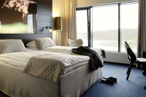 A bed or beds in a room at Scandic Havet