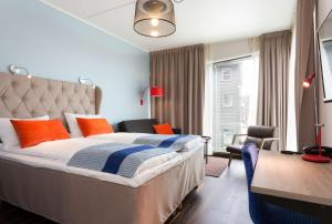 A bed or beds in a room at Scandic Stavanger City