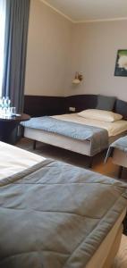 Łóżko lub łóżka w pokoju w obiekcie Pokoje Hotelowe Figaro