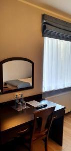 Telewizja i/lub zestaw kina domowego w obiekcie Pokoje Hotelowe Figaro
