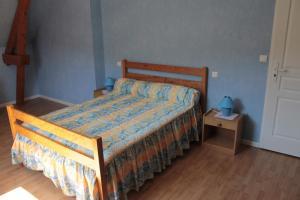 Un ou plusieurs lits dans un hébergement de l'établissement Gite Ladagnous