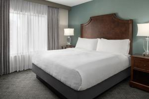 A bed or beds in a room at Embassy Suites San Antonio Riverwalk-Downtown
