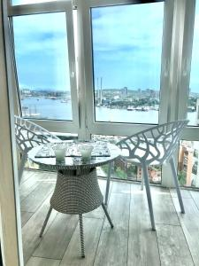 A balcony or terrace at Studio Apartment with Fantastic view in Center