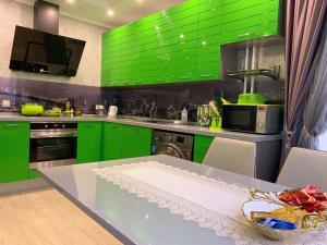 A kitchen or kitchenette at Уютная квартира в Рассказовке