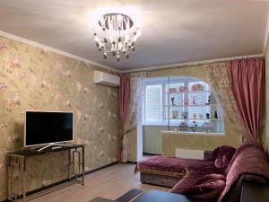 A seating area at Уютная квартира в Рассказовке