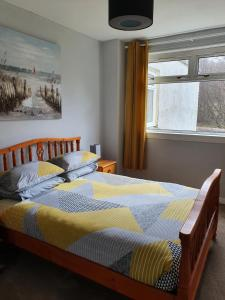 A bed or beds in a room at North Face Apartment , Fort William