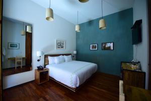 Cama o camas de una habitación en Hotel Los Amantes