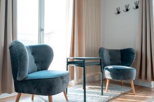 Ein Sitzbereich in der Unterkunft Hotel Alt-Weimar