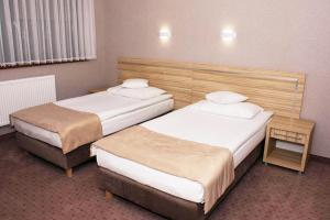 Łóżko lub łóżka w pokoju w obiekcie TSA Restauracja Hotel Aquarius