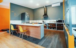 A kitchen or kitchenette at Friday Hostel