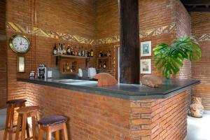 The lounge or bar area at Pousada Olho D'Água
