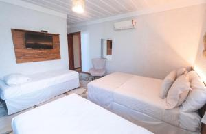 A bed or beds in a room at PIER BEACH CLUB