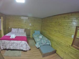 A bed or beds in a room at Pousada Bem Estar