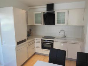 Kuchyň nebo kuchyňský kout v ubytování Appartement Silencio by Schladmingurlaub