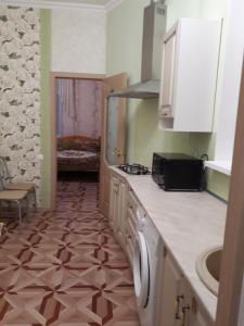 A kitchen or kitchenette at На Партизанской 29б
