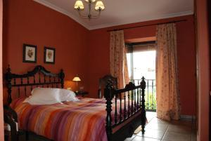 Cama o camas de una habitación en Casa Rural El Aguila