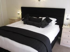 A bed or beds in a room at Druid House