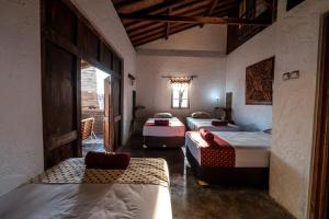 A bed or beds in a room at Nextdoor Homestay