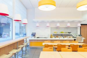A restaurant or other place to eat at ibis budget Antwerpen Centraal Station