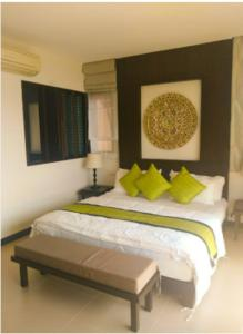 A bed or beds in a room at Point of view condos, tranquility bay, koh chang