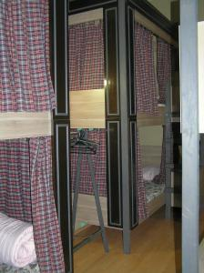 A bunk bed or bunk beds in a room at Hostel Balkonsky