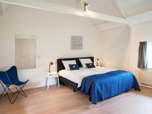 Ein Bett oder Betten in einem Zimmer der Unterkunft BizStay Cricket Mansion Apartments