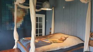 Een bed of bedden in een kamer bij B&B De Rijnban