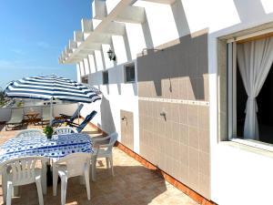 Uma varanda ou terraço em Rooftop Olhão-Algarve Apartamento com terraço vista mar