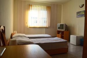 Posteľ alebo postele v izbe v ubytovaní Penzion Pompano