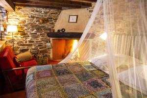 Uma cama ou camas num quarto em Moinho do Maneio