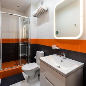 Ванная комната в APARTme Kremenchugskaya