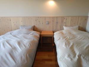 Letto o letti in una camera di Meiji no Okano Yado