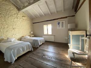 Cama o camas de una habitación en Ulle Gorri Rural House - Casa Rural