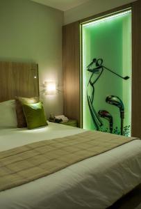 ゴルフ ロイヤル ホテルにあるベッド