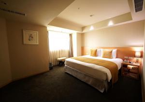 嘉義兆品酒店房間的床