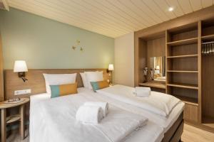 En eller flere senge i et værelse på Center Parcs Bispingen Lüneburger Heide