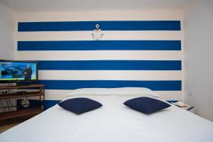 A bed or beds in a room at Blue Marlin Vacanze