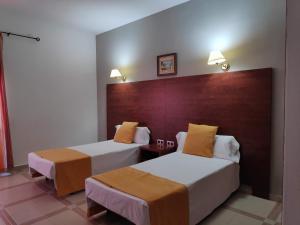 Cama o camas de una habitación en Hotel Perú by Bossh Hotels