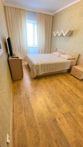 A bed or beds in a room at Apartment Internatsionalnaya 19а