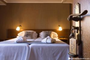 Cama o camas de una habitación en Hotel-Hostal Sport