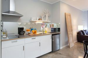 A kitchen or kitchenette at Emporium Lisbon Suites