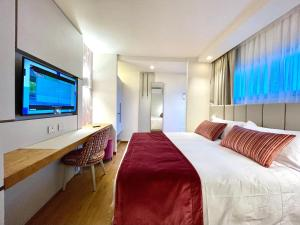 """Letto o letti in una camera di Campo di Golf Punta Ala """"19ª Buca Exclusive Room"""""""