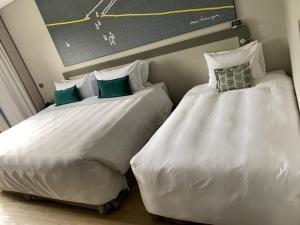 A bed or beds in a room at Royal Tulip Brasília Alvorada