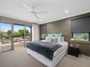 A bed or beds in a room at Lilies Luxury Retreats
