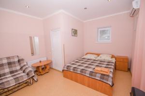 Кровать или кровати в номере Гостевой Дом Инжир