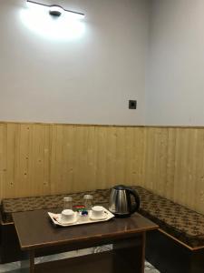 A kitchen or kitchenette at Hotel Rotara