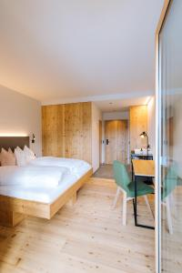 A bed or beds in a room at Thalers Mariandl