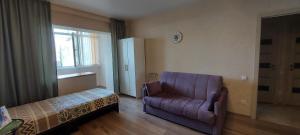 Гостиная зона в Апартаменты на Навагинской 16