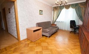 Гостиная зона в Standard Brusnika Apartments Akademicheskaya